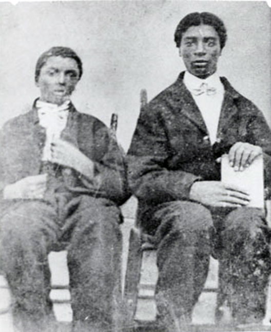 With his brother Jim, right, late 1870s