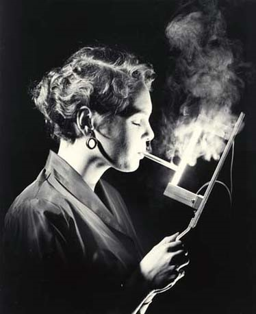 <p>Light From a Lamp, undated.  Cleveland&#8217;s Sharon Lee Brumley is using General Electric&#8217;s revolutionary new infrared lamp for lighting her cigarette. Courtesy: Smithsonian Institution Archives <sup>©</sup>General Electric</p>